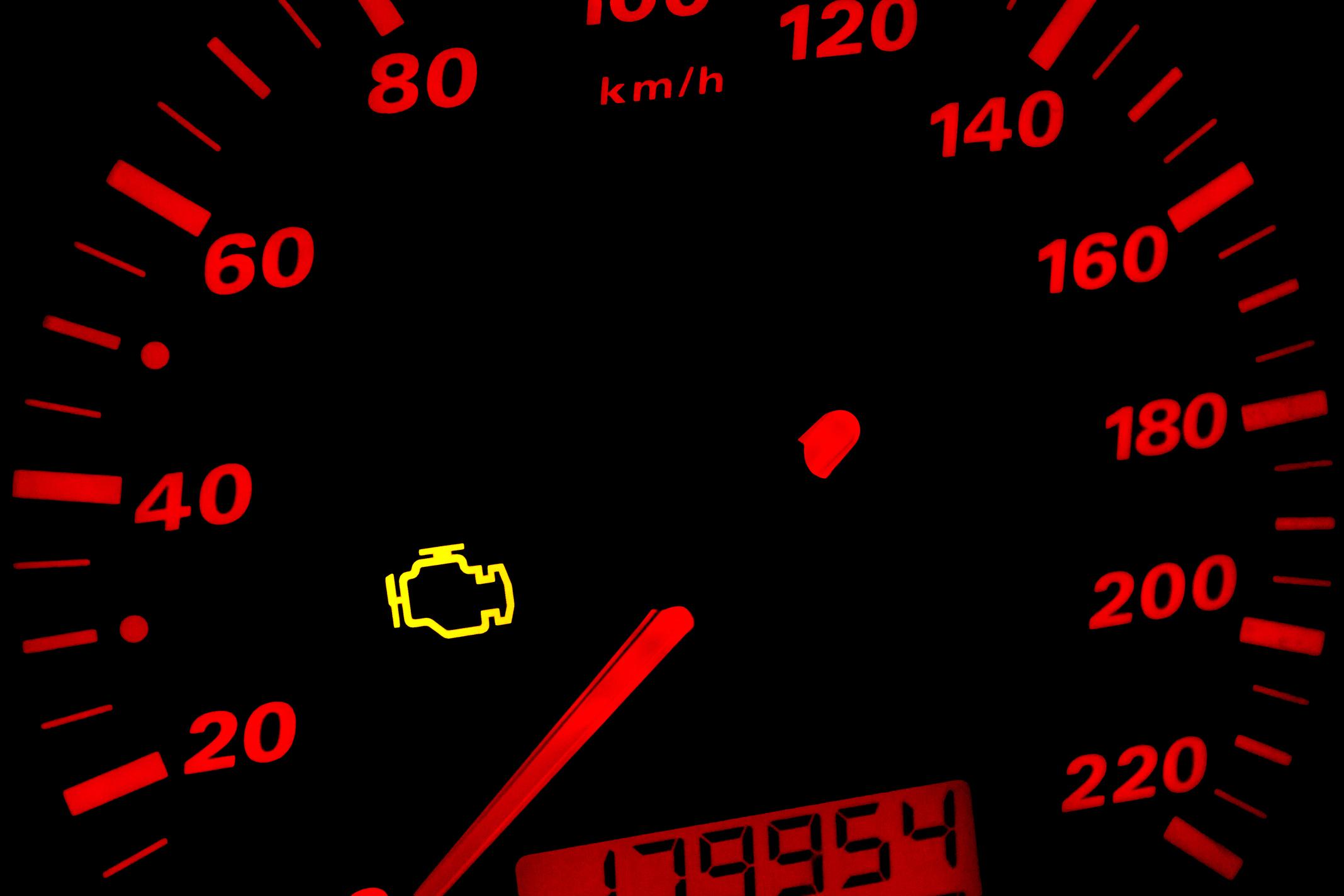 Check engine light car dashboard in closeup