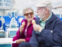 Happy Senior Couple Enjoying Ice Cream On The Deck of a Luxury Passenger Cruise Ship.