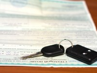 Insurance policy and key from the car about an alarm system charm.